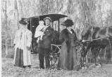John F. Irvine with Women and Buggy