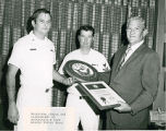 Dumas Receives a Plaque of Appreciation from the U.S. Navy