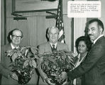 Mayor Woody Dumas Receiving Christmas Plants Grown by BRACA