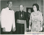 Woody Dumas, Bishop Robert Tracy, and Mrs. Dumas