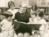 Tillie Scheneker Reading to Young Patrons