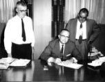 Jack Christian of Baton Rouge Signs the Fire Prevention Week 1958 Proclamation