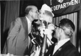 Miss Fire Prevention 1968 Receives a Kiss from Chief LeJeune